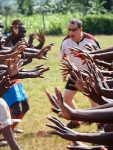 Coaches Across Continents Coach playing Scary Soccer in Western Kenya