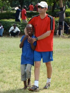 Nick Gates with Tyson, a young streetkid in Kisumu, Kenya