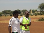coaches Oti and Florence during training.